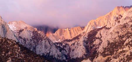 alpenglow: Beautiful light hits the mountain range above Alabama Hills Stock Photo