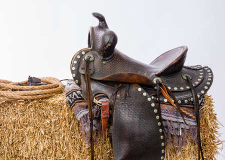 tooled: Studio shot of saddle on a hay bale Stock Photo
