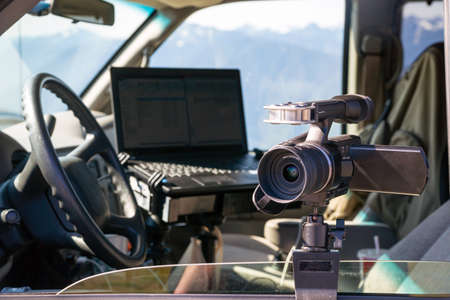 Camera and Laptop mounted on van window