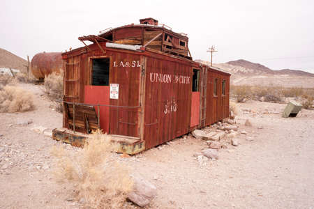 caboose: RHYOLITE, NEVADAUNITED STATES - NOVEMBER 19: An old railroad caboose sits abandoned now a tourist attraction in Death Valley November, 2014.