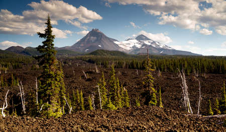 seemingly: A seemingly endless field of lava leads out to the Sisters near Bend Oregon