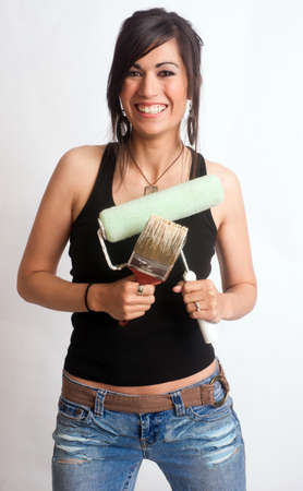 Woman about to get creative holding her painting tools photo