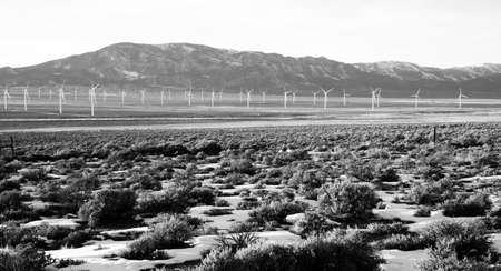 land use: Hard to use land becomes production again with the addition of wind turbines Stock Photo