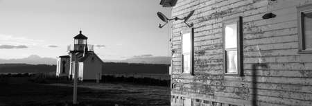 Lighthouses still operate to keep nautical vessels safe in the Puget Sound photo