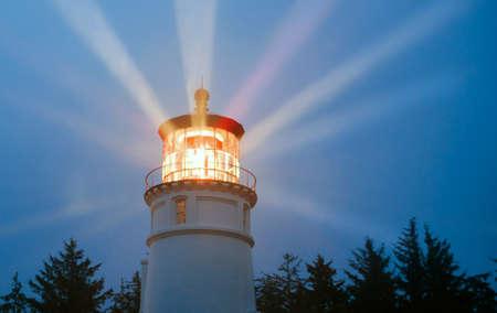 Lighthouse Beams Illumination Into Rain Storm Maritime Nautical Beacon Archivio Fotografico