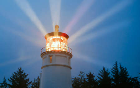 Lighthouse Beams Illumination Into Rain Storm Maritime Nautical Beacon 免版税图像