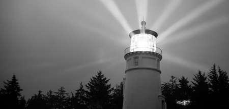 Lighthouse Beams Illumination Into Rain Storm Maritime Nautical Beacon Reklamní fotografie