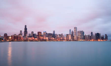 commercial real estate: A beautiful pink sunrise lights the long downtown Chicago skyline