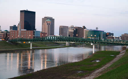 Sunrise comes to the Miami River flowing through Dayton Ohio