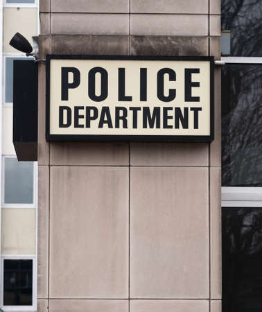 precinct station: Vertical composition of Police Department sign outside