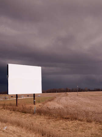 advertises: A thuderstorm passes as the billboard advertises nothing Stock Photo