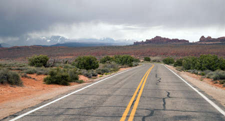 come in: Rain clouds come over the mountains in the Utah desert Stock Photo