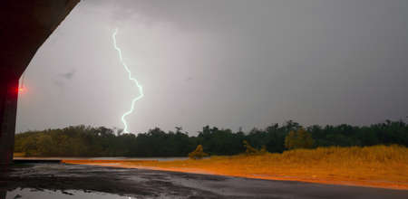 south texas: Lightning strikes outside the cover of a South Texas highway overpass Stock Photo