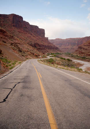 meanders: The river meanders down along highway 128 just south or Arches National Park
