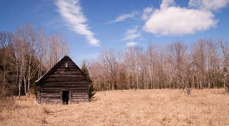 An abandoned cabin stands still after occupants are long gone Stock Photo