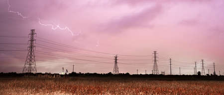inclement weather: Lightning Strikes over a power lines in southeast Texas Stock Photo