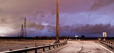 inclement weather: Lightning Strikes over a road in southeast Texas Stock Photo