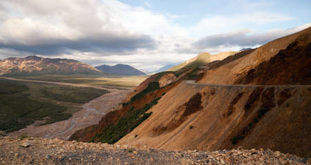 cutting through: The still primative road cutting through Denali late in the summer