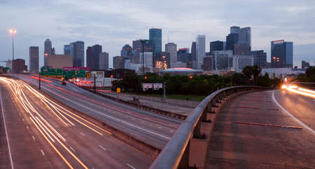 Night falls as rush hour winds down in Houston, Texas Foto de archivo