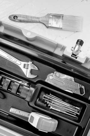 box cutter: Tape measure, wrench, fasteners, and box cutter arranged in a tool box Stock Photo