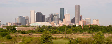 Green beltway under perfect Houston downtown city skyline