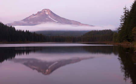 mt  hood national forest: Mount Hood stands alone in the fall at sunrise ubove peaceful Trillium Lake