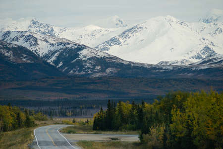 A bend in the road takes you along the base of beautiful Alaska Mountains