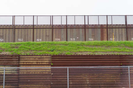 border patrol: Here is a section of fence seperating Mexico and California