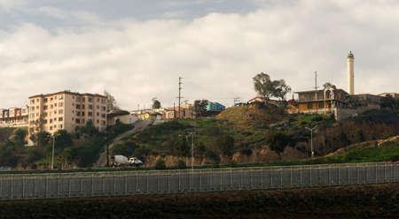 underprivileged: Tijuana Mexico Looking Across Barbed Wire Boundary San Diego California Stock Photo