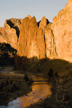 smith rock: Sun Rises on Smith Rock Oregon Crooked River Reflection