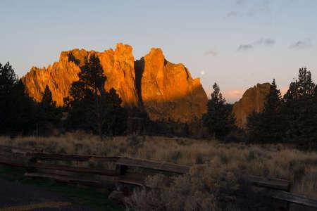 smith rock: The Moon Sets as Sun Rises on Smith Rock Oregon