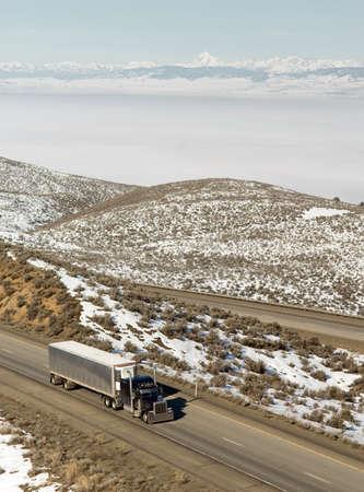 18 wheeler: 18 Wheeler gains ground down interstate highway in mountainous Washington State