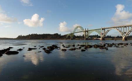 bridging: The river meets the Pacific Ocean under the Newport Bridge