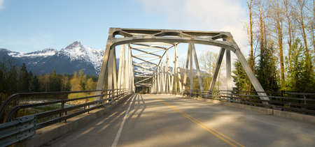 whitehorse: Pavement on bridge crossing the Sauk River in North Cascades