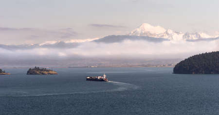 mount baker: An Oil Tanker makes it way towards the sea from Anacortes, WA