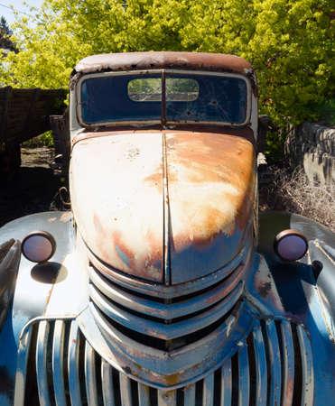 junkyard: An old truck sits rotting in the junkyard