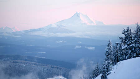 pacific crest trail: Mt Jefferson can be seen miles away from a vantage point high on Mt Hood on a crisp winter evening