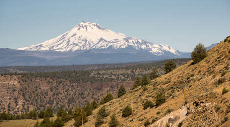 cascade range: Rocky desert like landscape stands in the foreground near Mt Jefferson on Warm Springs Reservation Stock Photo