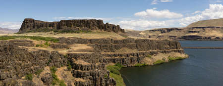 butte: The River rolls by Horsethief Butte in the Columbia River Valley
