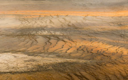 prismatic: Saturated color appears as the fluid makes its way down from the Grand Prismatic Spring