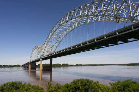 The Mississippi River flows under the Hernando de Soto Bridge looking towards Arkansas