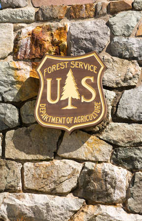 wall mounted: Rock wall mounted US Forest Service sign Editorial