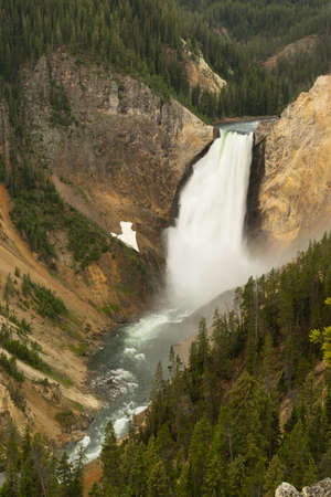 lower yellowstone falls: Water flows fast over the edge in the Grand Canyon of the Yellowstone Stock Photo