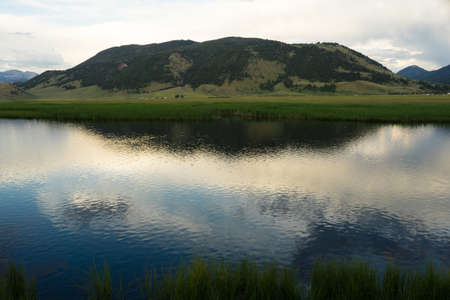 Smooth water reflection at the National Elk Refuge in Jackson Wyoming