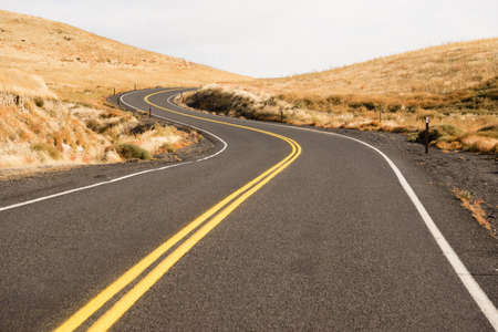 blacktop: Two Lane blacktop road leads through scenic countryside Stock Photo