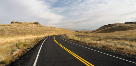 blacktop: Two Lane blacktop road leads through scenic Oregon State