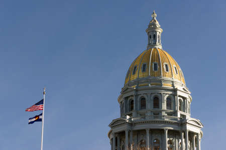 The US and State flags fly at Denvers Capital