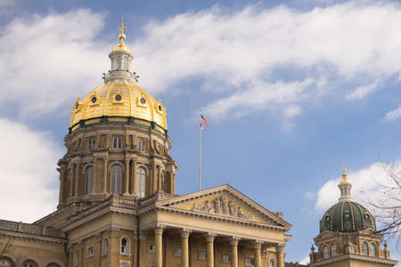 The US and State flags fly at Des Moines Capital