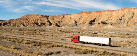 A trucker navigates this Utah highway in his big rig