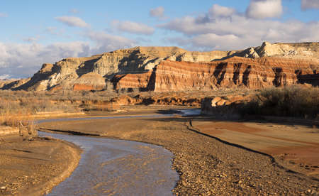 Dramatic light and clouds makes this Utah scene pop late afternoon at Pahreah River Stock Photo